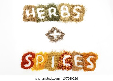 a mixture of different dried herbs and spices on a white background, spelling out the word 'herbs + spices'