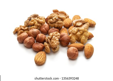Mixture of different nuts almonds, hazelnuts and walnuts isolated on white background