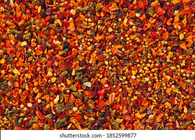A mixture of different spices close up. Textures of colorful spices and condiments. - Shutterstock ID 1852599877
