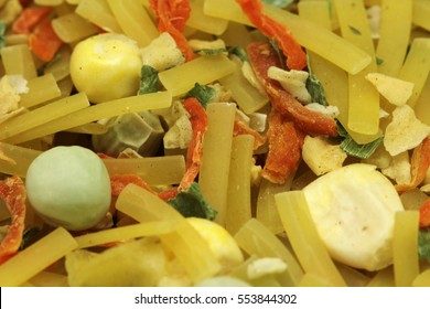 a mixture of dry noodles and vegetables close-up
