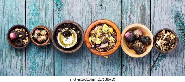 Mixture herbal floral tea in a wooden mortar