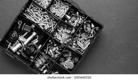 A mixture of nuts, bolts, washers, and other hardware