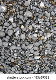 Mixture of Pebbles , including flint, granite, jasper,  quartz, and slate stones with smooth and rough texture.