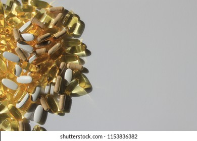 Mixture of prescription drugs on the left with white copy space on the right symbolising drug taking, prescription medicine and healthy lifestyle