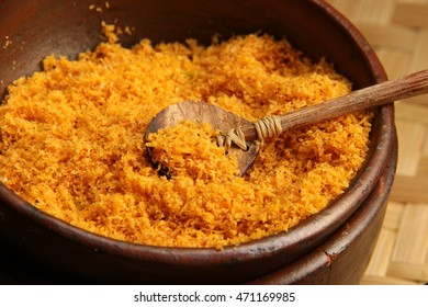 Mixture of roasted grated coconut and ground dried shrimp, commonly used as one of the topping for Kerak Telor, It is placed in an earthenware bowl and uses coconut shell teaspoon as the scoop.