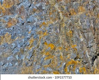 Mixture of rocks-gneiss, granite, diabase.