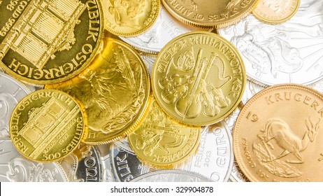 mixture of silver and golden coins with different nominal value and size, background made of precious coins made of pure gold and silver from above, golden phillharmoniker, golden american buffalo