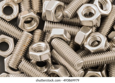 A mixture of stainless steel nuts and bolts / Nuts and bolts mix