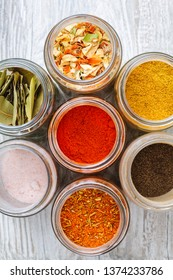 Mixtures of spices. Colorful spices and dried vegetables in jars.