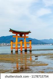 Miyajima, Hiroshima, Japan at the floating gate of Itsukushima Shrine.(gate sign reads Itsukushima Shrine)