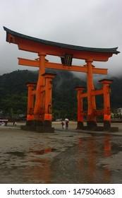 Miyajima, Hiroshima, Japan; July 19yh 2019; Itsukushima Shrine arc or torii with the low tide before its reparation