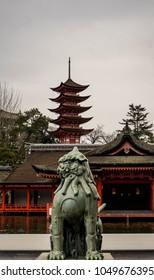 Miyajima, Hiroshima Prefecture, Japan: Itsukushima Shrine with its Pagoda and Statue