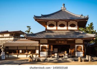 Miyajima Island, Hiroshima Bay, Japan -November 3, 2018: Local souvenir shop with traditional Japanese roof at the very popular Miyajima Island in Japan.