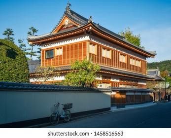 Miyajima Island, Hiroshima Bay, Japan -November 7, 2018: Local traditional style building with a beautifully decorated  roof at the very popular Miyajima Island in Japan.