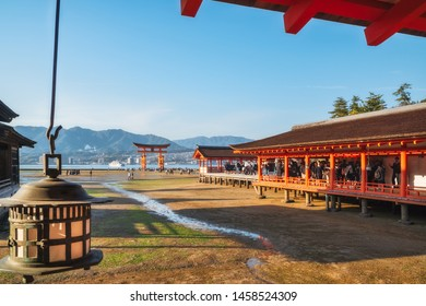 Miyajima Island, Hiroshima bay, Japan -November 7, 2018: Itsukushima Shrine - View of Hira-butai, the open-air stage, located in front of the Main Shrine -with the famous Torii Gate in the background.