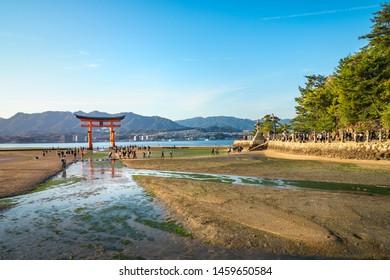 Miyajima Island, Hiroshima Bay, Japan -November 7, 2018: The famous Torii Gate at Itsukushima Shrine, World Heritage listed Shinto Shrine at Miyajima Island, Japan.