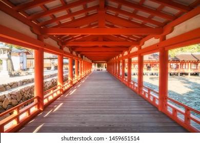 Miyajima Island, Hiroshima, Japan -November 7, 2018: The East  and West Corridors extend from the entrance of Itsukushima Shrine, past the Marodo Shrine to the purification hall of the Main Shrine.