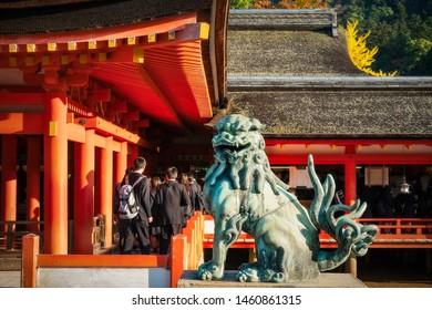 Miyajima Island, Hiroshima, Japan -November 7, 2018: Lion sculpture in the corner of the open-air stage at Itsukushima Shrine on Miyajima Island, Hiroshima Bay, Japan.