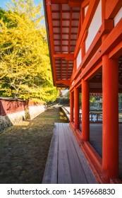 Miyajima island, Hiroshima prefecture, Japan - November 7, 2018: Architectural Details at Itsukushima Shrine with it's stricking vermilion color, on a sunny day in autumn at Miyagima, Japan.