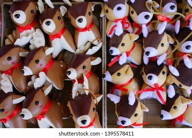 MIYAJIMA, JAPAN -26 FEB 2019- View of deer stuffed animal toys for sale in a souvenir shop on the island of Itsukushima (Miyajima), where wild deer roam free and are a tourist attraction.