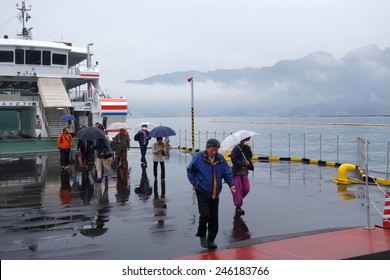 MIYAJIMA, JAPAN - DECEMBER 12: Tourist takes ferry to Miyajima, Japan on December 12, 2014. The ferries depart frequently and it takes 10 minutes to Miyajima.