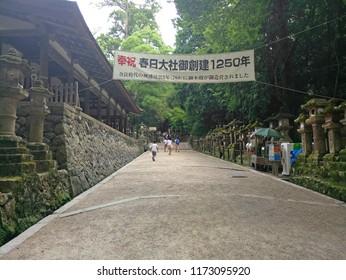 Miyajima, Japan - June 20, 2018: Tourist visit Itsukushima Shrine on Miyajima Island. Miyajima island is a famous island shrine-town is a Unesco World Heritage Site and a major tourism destination