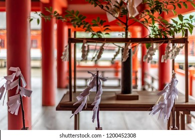 "Miyajima, Japan - June 27 2017: Itsukushima Shrine, Japan. Itsukushima Shrine is a Shinto shrine on the island of Itsukushima (popularly known as Miyajima), best known for its ""floating"" torii gate."
