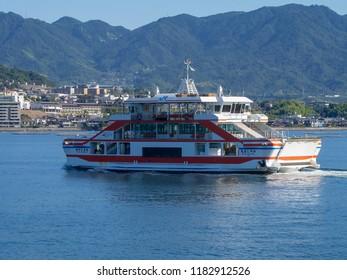 "Miyajima/Japan - August 8 2018: The ferry to Itsukushima island, Japan. The island is popularly known as Miyajima, which means ""Shrine Island""."