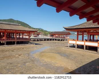 "Miyajima/Japan - August 8 2018: Itsukushima Shrine, Japan. Itsukushima Shrine is a Shinto shrine on the island of Itsukushima (popularly known as Miyajima), best known for its ""floating"" torii gate."