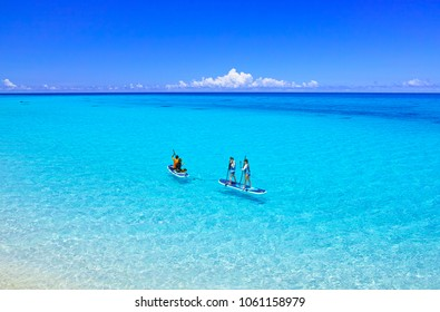 Miyakojima, Japan-June 29, 2017: Miyakojima in summer. People enjoying marine sports at a beautiful sea spreading along Shimoji Airport on Shimojima in the west side of Irabu-jima.