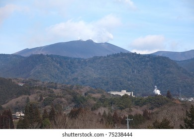 MIYAZAKI, JAPAN - FEBRUARY 18: Becoming active January 19, 2011, gases vent from the caldera of the volcano Shinmoedake. Hot spring hotels are in the foreground. Miyazaki, Japan, February 18, 2011.