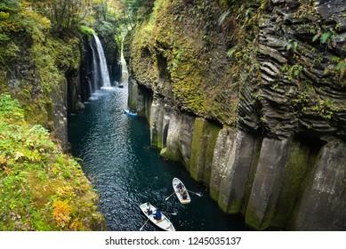 Miyazaki, Japan - November 21, 2018: Tourists are rowing the boat and enjoy the beauty of Manai Fall, Miyazaki, Japan