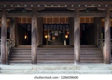 Miyazaki, Japan - November 5, 2018: Facade of the historical wooden main Miyazaki Jingu shrine at dusk