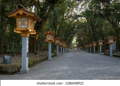 Miyazaki, Japan - November 5, 2018: Long lane with lanterns through the park to the torii of the Miyazaki Jingu shrine