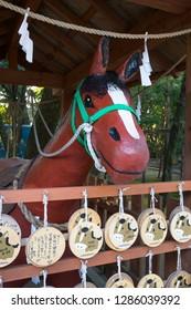 Miyazaki, Japan - November 5, 2018: Nade Uma, Rubbing horse, shrine to console the spirits of war horses at the Miyazaki Jingu shrine grounds