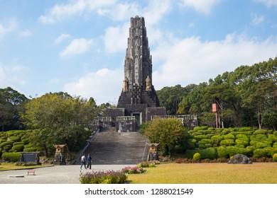 Miyazaki, Japan - November 5, 2018: Peace Tower, Heiwadainoto, a tower constructed of stones sent from all around Asia in Heiwadai Park, Miyazaki