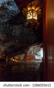 Miyazaki, Japan - November 6, 2018: Entrance to the Udo Shrine set in a cave on the side of a cliff illuminated by a lantern
