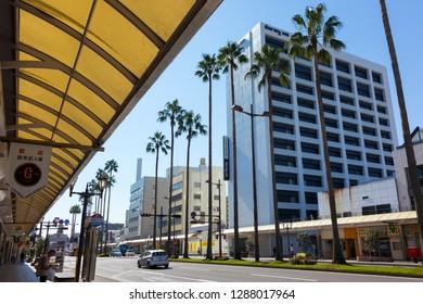 Miyazaki, Japan - November 7, 2018: Tachibanadori street with modern architecture and palm trees in Miyazaki, Japan