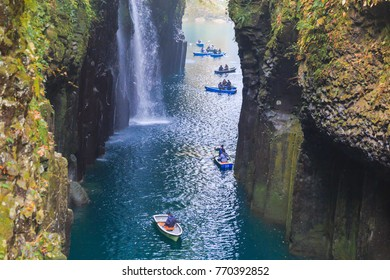 MIYAZAKI,JAPAN-NOVEMBER 13,2017 : Travelers on a rowing boat at takachiho gorge in Leaves color change season