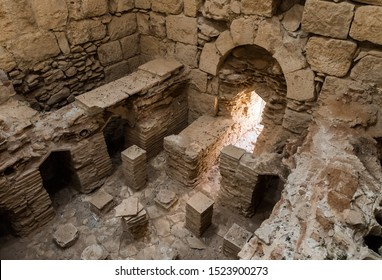 Mizpe Ramon, Israel, September 28, 2019 : Remains of the interior of the Roman baths on the territory ruins of the Nabataean city of Avdat, located on the incense road in the Judean desert in Israel.