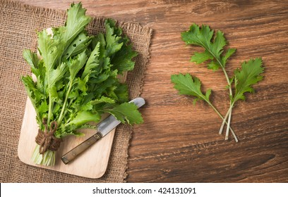 mizuna vegetation on wood plate and wood background