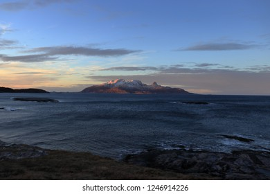 MJELLE, NORDLAND COUNTY / NORWAY - DECEMBER 01 2018: Mjelle Beach in Northern Norway near Bodo at the winter. A tide of the sea. A view on the Landegode island