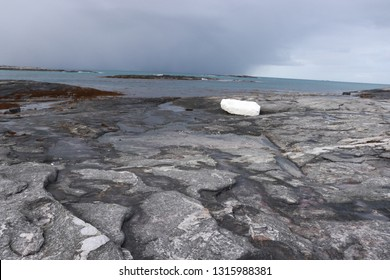 MJELLE, NORDLAND COUNTY / NORWAY - FEBRUARY 17 2019: Plastic pollution in the ocean. Polystyrene buoy  at the Mjelle Beach in Northern Norway near Bodo