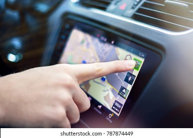 Mlada Boleslav, Czech Republic - January 4 2018: SKODA OCTAVIA - Navigation system in car. Man's hand touches the display.