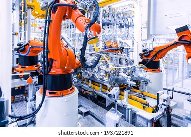 Mlada Boleslav, Czech Republic - May 30, 2015: Skoda Auto celebrates 120 years since its establishemnt by Open Doors Day. Welding robots show visitors slow operating of car manufacturing.