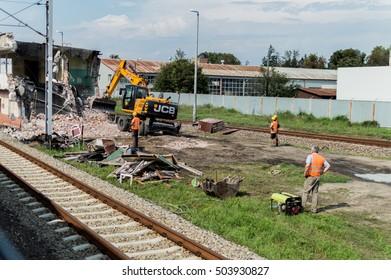 Mlawa, Poland, August 11, 2016: JCB excavator demolishes old building.