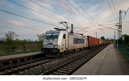 Mlcechvosty, Czech Republic - April 28, 2018 - Container train by Metrans HHLA in head with modern silver electric locomotive Bombardier Traxx no. 386 025-1.