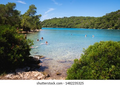 Mljet National Park, Mljet island, Croatia - August 4, 2019: people in a small lake in Mljet national park, travel destination, outdoor activities in a natural paradise.