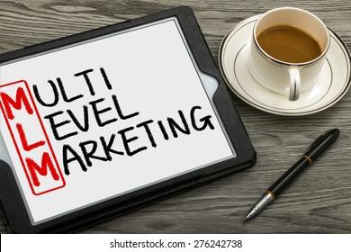 MLM concept:multi level marketing handwritten on tablet pc
