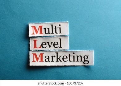 mlm - multi level marketing on blue paper